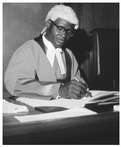 A Zambian judge overseeing a judicial tribunal in the attire of the British colonial legal tradition, Zambia.