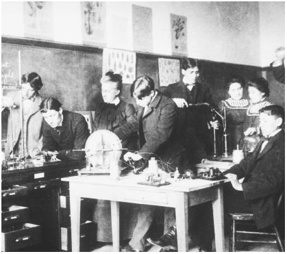 These Apache boys and girls are conducting physics experiments at the Carlisle Indian School in Pennsylvania, c. 1915.