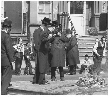 Orthodox Jews burn hametz in preparation for Passover in the Williamsburg section of New York. Hametz, or leavened foods, are not permitted to be eaten during Passover.